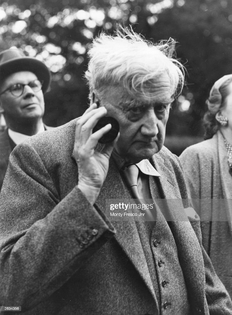 Ralph Vaughan Williams (1872 - 1958) the English composer at 83 years listening to a music recital by means of an ear trumpet. He is at the Surrey residence of Captain Evelyn Broadwood, head of the piano-making family.