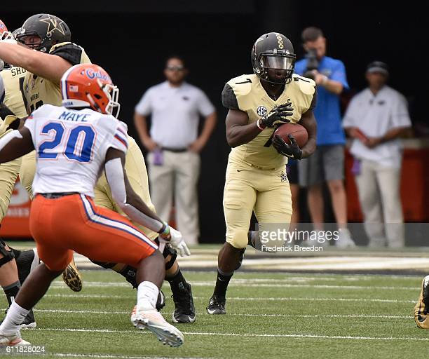 Ralph Webb of the Vanderbilt Commodores rushes against Marcus Maye of the Florida Gators during the first half at Vanderbilt Stadium on October 1...