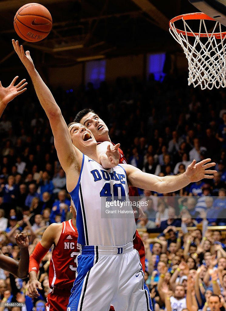 Ralston Turner #22 and Jordan Vandenberg #14 of the North Carolina State Wolfpack battles for a rebound with Marshall Plumlee #40 of the Duke Blue Devils during their game at Cameron Indoor Stadium on January 18, 2014 in Durham, North Carolina.