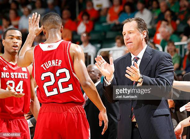 Ralston Turner celebrates his scoring play with TJ Warren and head coach Mark Gottfried of the North Carolina State Wolfpack as he comes off the...