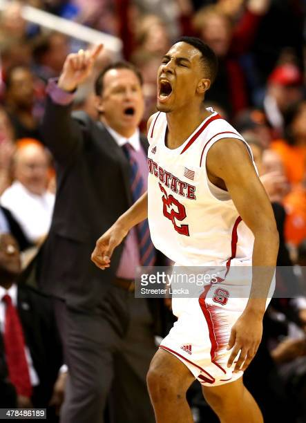 Ralston Turner of the North Carolina State Wolfpack and head coach Mark Gottfried celebrate against the Miami Hurricanes during the second round of...