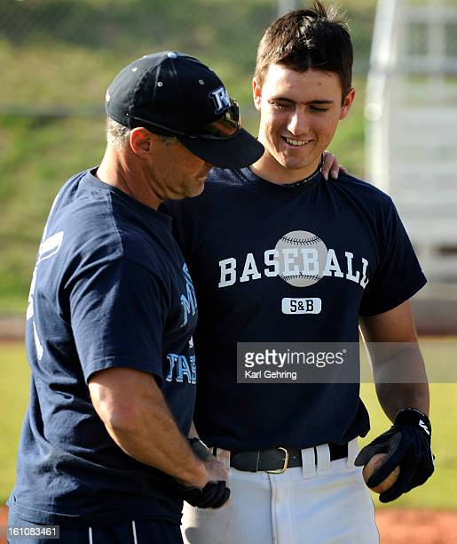 SP16PRPBASE Ralston Valley High School baseball coach Shane Freehling left had a private word with Nate Jurney at the end of the last practice of the...