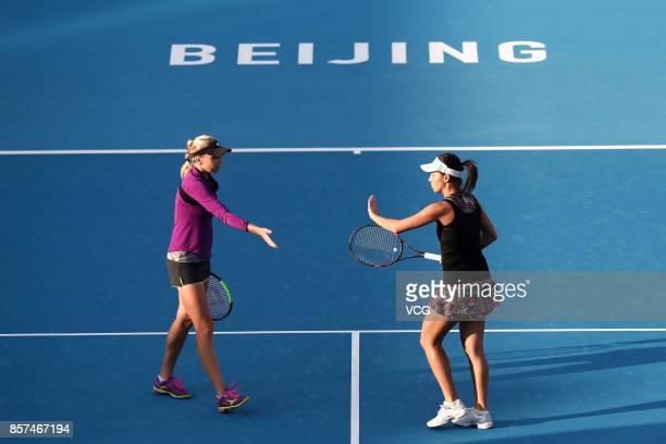 Raluca Olaru of Romania and Lyudmyla Kichenok of Ukraine compete during Women's doubles second round match against Gabriela Dabrowski of Canada and...