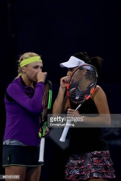 Raluca Olaru of Romania and Lyudmyla Kichenok of Ukraine react during the doubles match against Gabriela Dabrowski of Cananda and Yifan Xu of China...