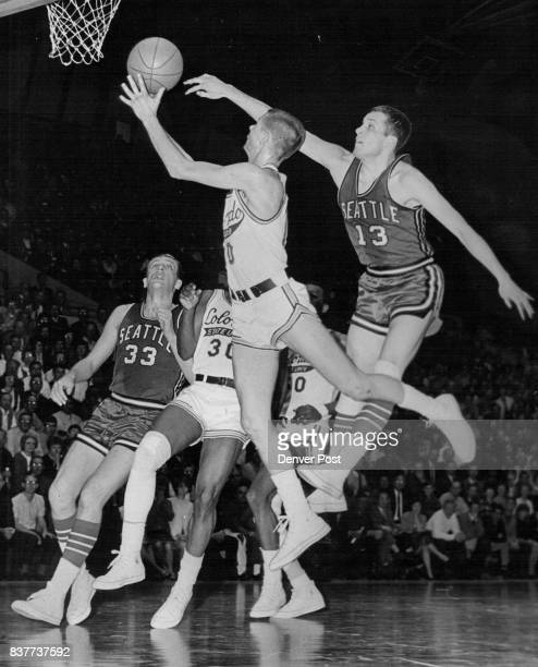 Ram Guard Tom Nowicki Drives for LefthandedLayup Attempt Against Seattle Steve Looney of the Chiefs stops scoring bid by reaching out to bat the...