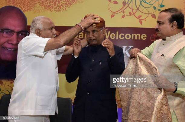 Ram Nath Kovind the presidential election candidate of NDA is being felicitated by BJP Karnataka president BS Yeddyurappa and Union minister of...