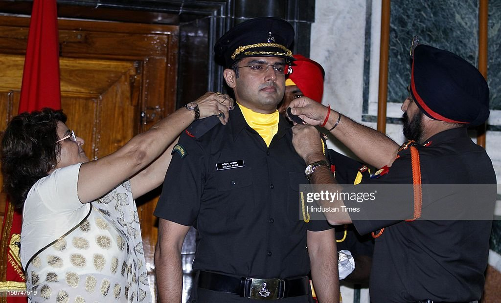 'NEW DELHI, INDIA- SEPTEMBER 6: Rama Pilot, mother of Union Minister Sachin Pilot and Chief of the Army Staff, General Bikram Singh removing flap during peeping ceremony to Sachin Pilot as Lieutenant into the Territorial Army (TA) as a regular officer on September 6, 2012 in New Delhi, India. (Photo by Sanjeev Verma/Hindustan Times via Getty Images)'