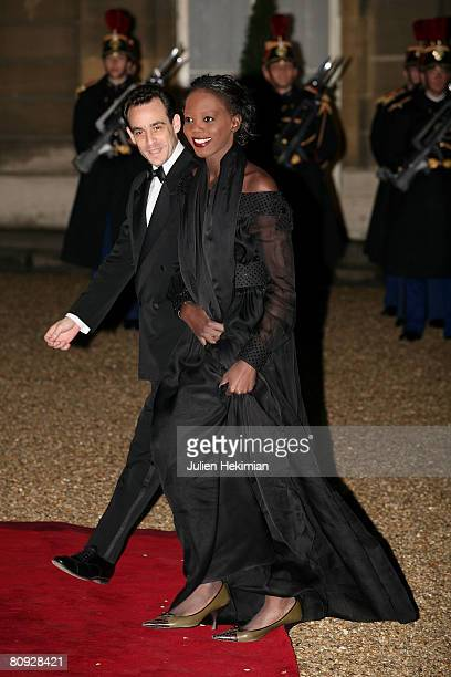 Rama Yade and her husband attend the state dinner in honor of Israeli President Shimon Perez at the Elysee Palace on March 10 2008 in Paris France