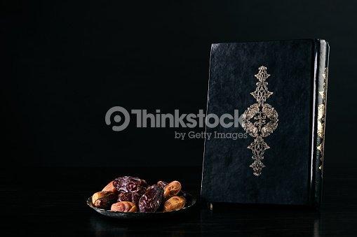 ramadan atmosphere quran koran kareem book and silver dish with dry