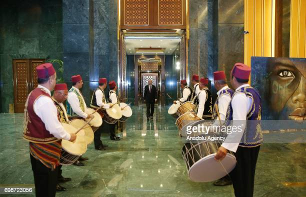 Ramadan drummers perform as Turkish President Recep Tayyip Erdogan attends an iftar dinner hosted by him with the tradesman at Presidential Complex...