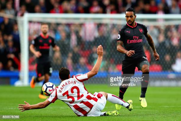 Ramadan Sobhi Ahmed of Stoke City challenges Theo Walcott of Arsenal during the Premier League match between Stoke City and Arsenal at Bet365 Stadium...