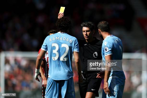 Ramadan Sobhi of Stoke City is shown a yellow card by referee Lee Probert during the Premier League match between Southampton and Stoke City at St...