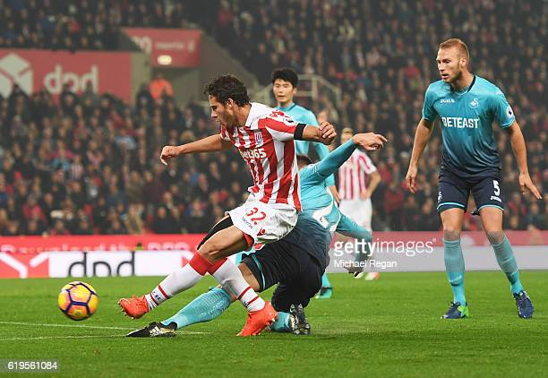 Ramadan Sobhi of Stoke City shoots at goal which leads to an own goal by Alfie Mawson of Swansea City for their second goal during the Premier League...