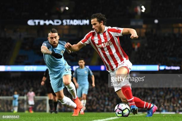 Ramadan Sobhi of Stoke City takes on Nicolas Otamendi of Manchester City during the Premier League match between Manchester City and Stoke City at...