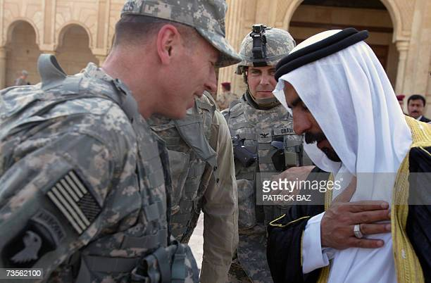 Iraq's alAnbar province tribe leader Abdel Sattar Abu Risha greets new US commander in Iraq General David Petraeus in Ramadi 13 March 2007 Petraeus...