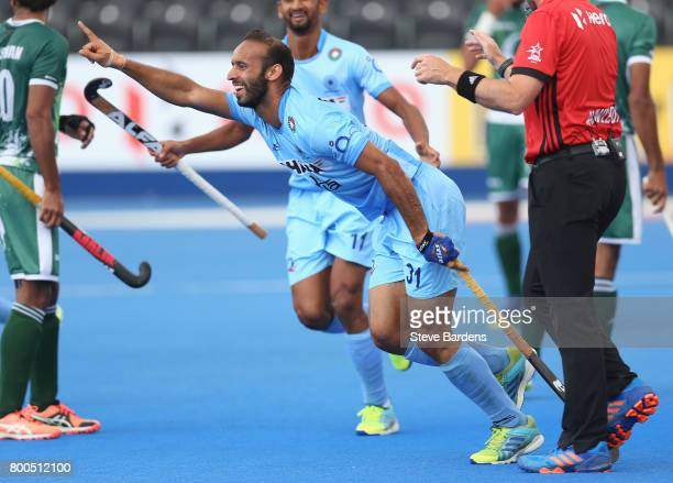 Ramandeep Singh of India celebrates scoring their teams fourth goal during the 5th8th place match between Pakistan and India on day eight of the Hero...