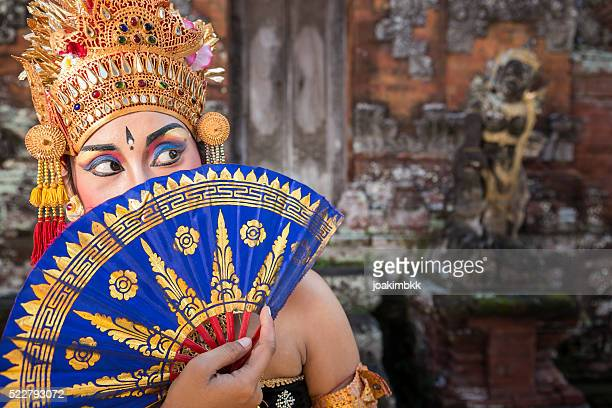 Ramayana Bali dancer with fan in a temple