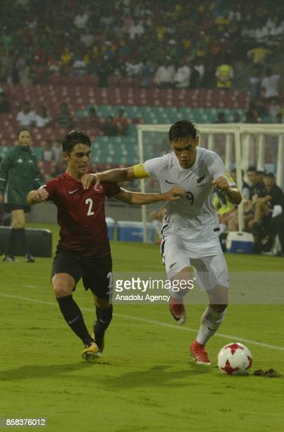 Ramazan Emirhan Civelek of Turkey U17 in action against Max Mata of New Zealand U17 during the FIFA U17 World Cup India 2017 football match between...