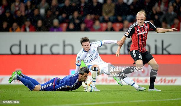 Ramazan Oezcan goalkeeper of Ingolstadt takes away the ball from the foot of Hamburgs Nicolai Mueller during the Bundesliga match between FC...