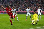 Ramazan Oezcan keeper of Ingolstadt saves a shot by Robert Lewandowski of Bayern Muenchen during the Bundesliga match between FC Bayern Muenchen and...
