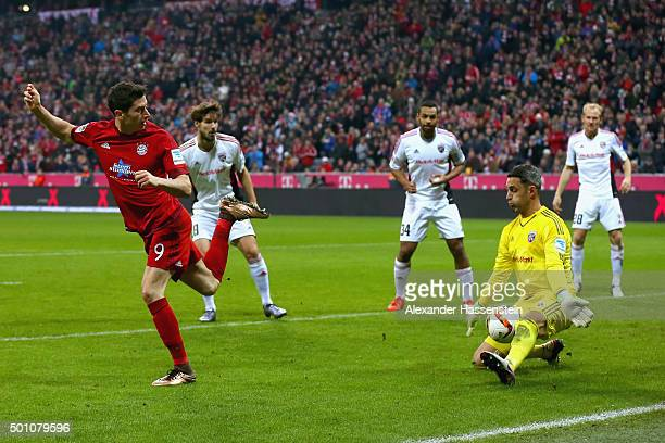 Ramazan Oezcan keeper of Ingolstadt saves a shot by Robert Lewandowski of Bayern Muenchen during the Bundesliga match between FC Bayern Muenchen and...