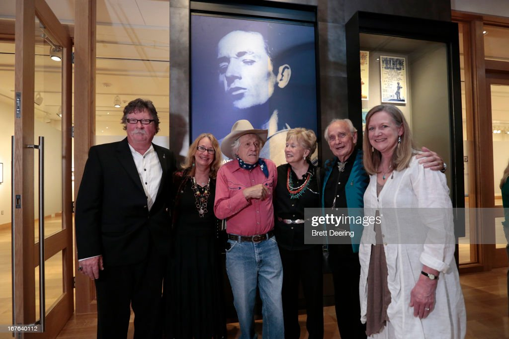 Ramblin' Jack Elliott and patrons pose for photos at the Woody Guthrie Center on April 26, 2013 in Tulsa, Oklahoma.