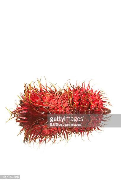 Rambutan with reflection on water surface