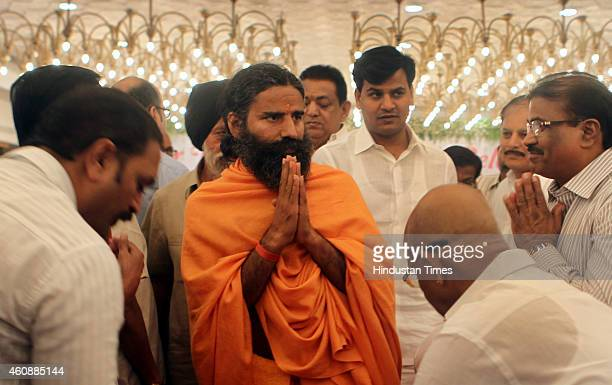 Ramdev Baba attending the prayer meeting of Varija Shetty mother of his follower Sudhakar Shetty at Tulip Star Hotel Juhu on December 28 2014 in...