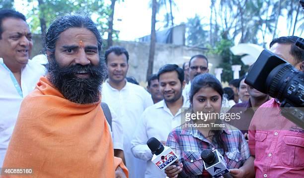 Ramdev Baba talks with media after attending the prayer meeting of Varija Shetty mother of his follower Sudhakar Shetty at Tulip Star Hotel Juhu on...