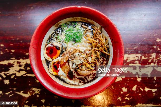 Ramen soup with noodles, pork and egg, high angle view
