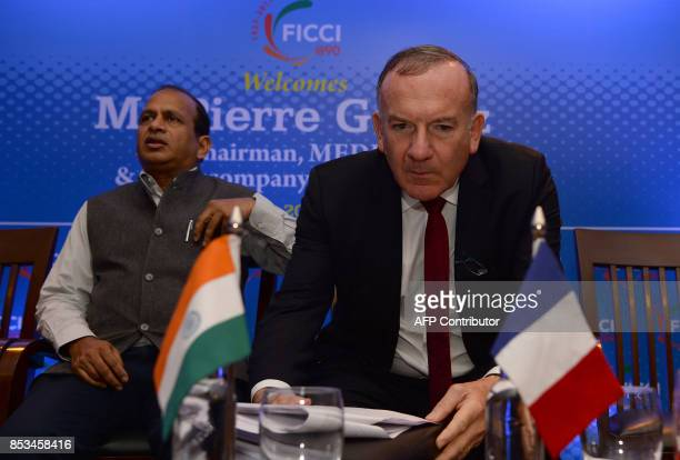 Ramesh Abhishek Indian secretary for the department of industrial policy and promotion and Pierre Gattaz head of the French employers union MEDEF...