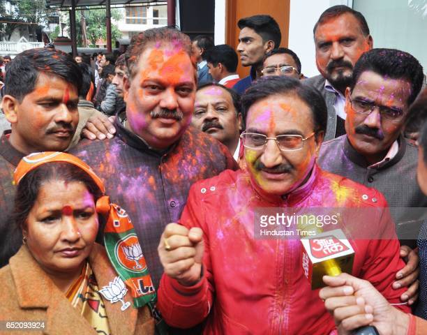 Ramesh Pokhriyal Nishank celebrating after landslide victory in Uttar Pradesh and Uttarakhand assembly elections at BJP office on March 11 2017 in...