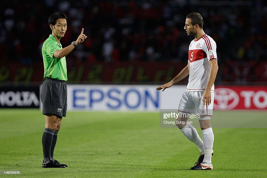 Ramez Dayoub of Lebanon talks with referee Toma Masaaki during the FIFA World Cup Asian Qualifier match between South Korea and Lebanon at Goyang Stadium on June 12, 2012 in Goyang, South Korea.