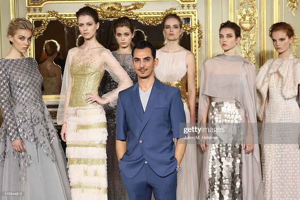 Rami Al Ali poses with models before his show as part of Paris Fashion Week Haute-Couture Fall/Winter 2013-2014 at on July 1, 2013 in Paris, France.