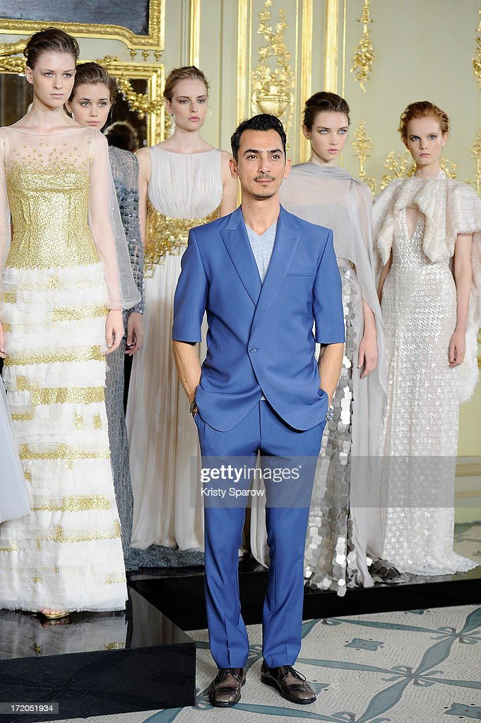 Rami Al Ali poses with models during Rami Al Ali show as part of Paris Fashion Week Haute-Couture Fall/Winter 2013-2014 at on July 1, 2013 in Paris, France.