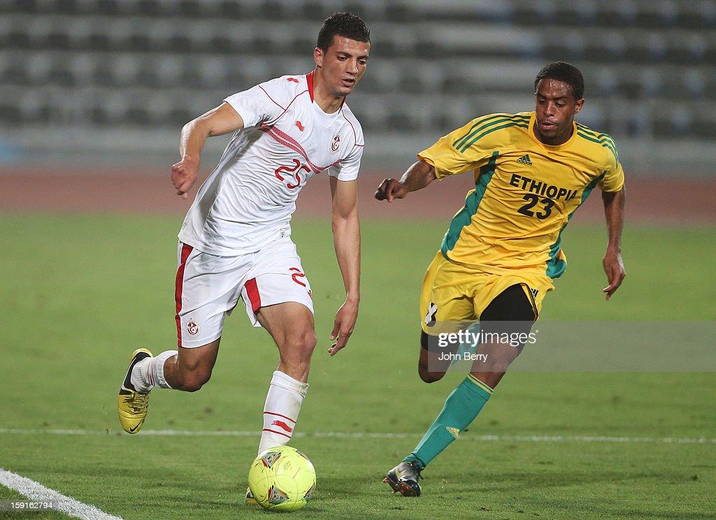 Rami Bedoui of Tunisia takes the ball past Zeihun Tadesse of Ethiopia during the international friendly game between Tunisia and Ethiopia at the Al Wakrah Stadium on January 7, 2013 in Doha, Qatar.