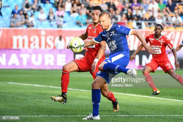 Rami Bensebaini of Rennes and Stephane Darbion of Troyes during the Ligue 1 match between Troyes AC and Stade Rennais at Stade de l'Aube on August 5...
