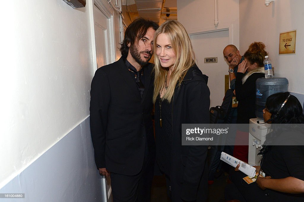 Rami Jaffee (L) and actress Daryl Hannah pose backstage at the GRAMMYs Dial Global Radio Remotes during The 55th Annual GRAMMY Awards at the STAPLES Center on February 8, 2013 in Los Angeles, California.