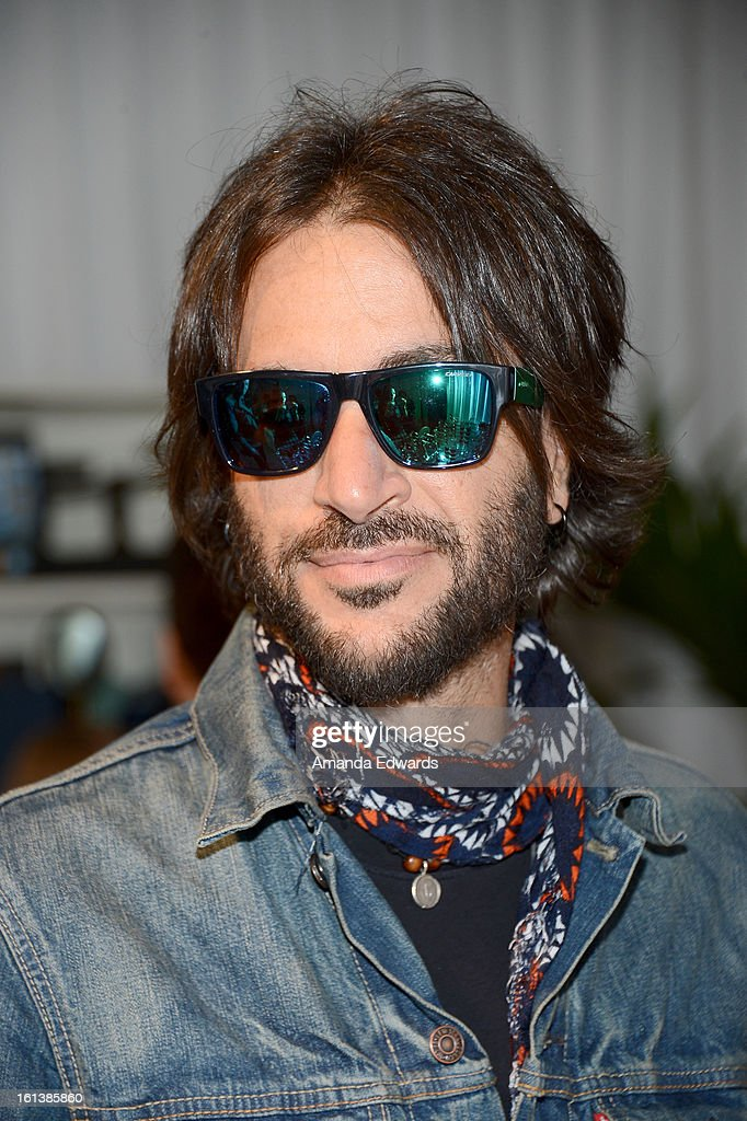 Rami Jaffee in Carrera CA5002S poses with SOLSTICE Sunglasses and Safilo USA during the 55th Annual GRAMMY Awards at the STAPLES Center on February 9, 2013 in Los Angeles, California.