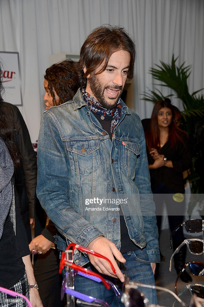 <a gi-track='captionPersonalityLinkClicked' href=/galleries/search?phrase=Rami+Jaffee&family=editorial&specificpeople=234780 ng-click='$event.stopPropagation()'>Rami Jaffee</a> poses with SOLSTICE Sunglasses and Safilo USA during the 55th Annual GRAMMY Awards at the STAPLES Center on February 9, 2013 in Los Angeles, California.