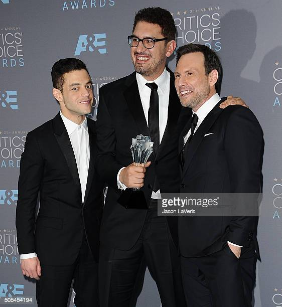 Rami Malek Sam Esmail and Christian Slater pose in the press room at the 21st annual Critics' Choice Awards at Barker Hangar on January 17 2016 in...