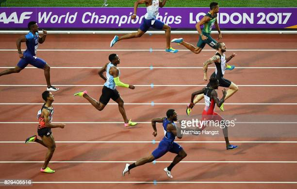 Ramil Guliyev of Turkey leads Jereem Richards of Trinidad and Tobago and Wayde van Niekerk of South Africa before he crosses the line to win the mens...