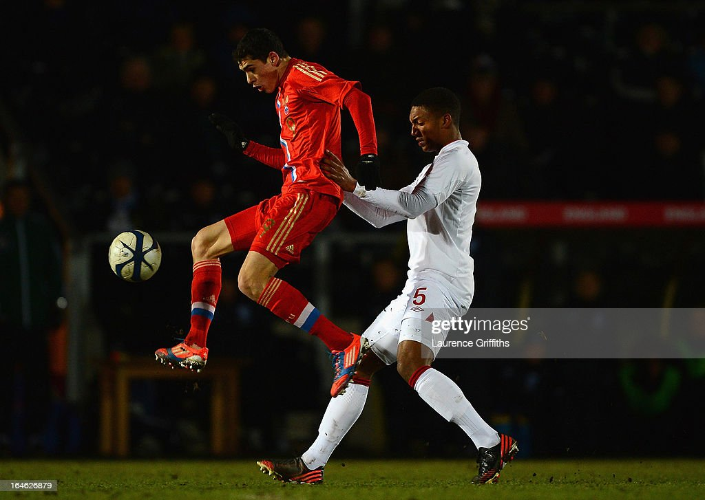 Ramil Sheidaev of Russia battles with Joseph Gomez of England during the UEFA European Under-17 Championship Elite Round match between England Under-17 and Russia U-17at Pirelli Stadium on March 25, 2013 in Burton-upon-Trent, England.