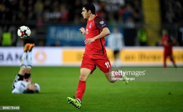 Ramil Sheydaev of Azerbaijan scores the equalizing goal while Shkodran Mustafi lies injured on the field during the FIFA 2018 World Cup Qualifier...
