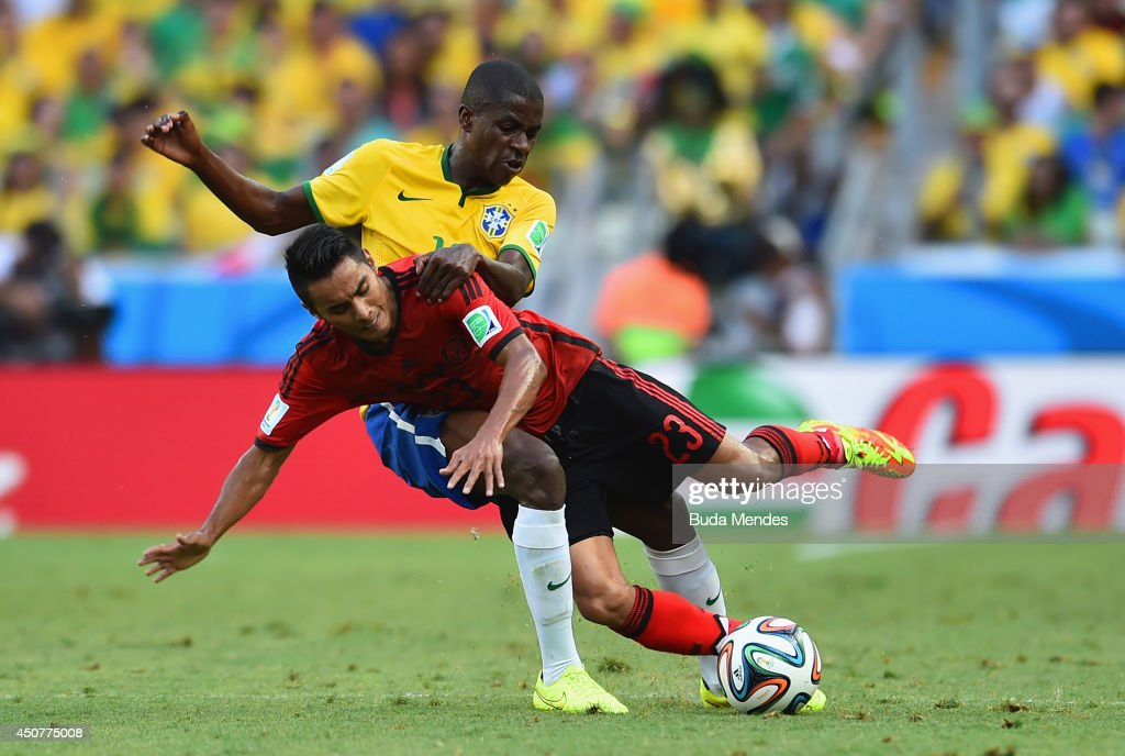 Ramires of Brazil and Jose Juan Vazquez of Mexico collide during the 2014 FIFA World Cup Brazil Group A match between Brazil and Mexico at Castelao on June 17, 2014 in Fortaleza, Brazil.