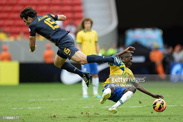 Ramires of Brazil and Mile Jedinak of Australia fight for the ball during the International friendly between Brazil and Australia at Mane Garrincha...