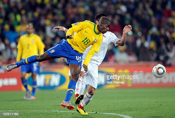Ramires of Brazil heads the ball away from Mauricio Isla of Chile during the 2010 FIFA World Cup South Africa Round of Sixteen match between Brazil...