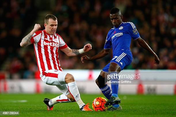 Ramires of Chelsea and Glenn Whelan of Stoke City compete for the ball during the Barclays Premier League match between Stoke City and Chelsea at...