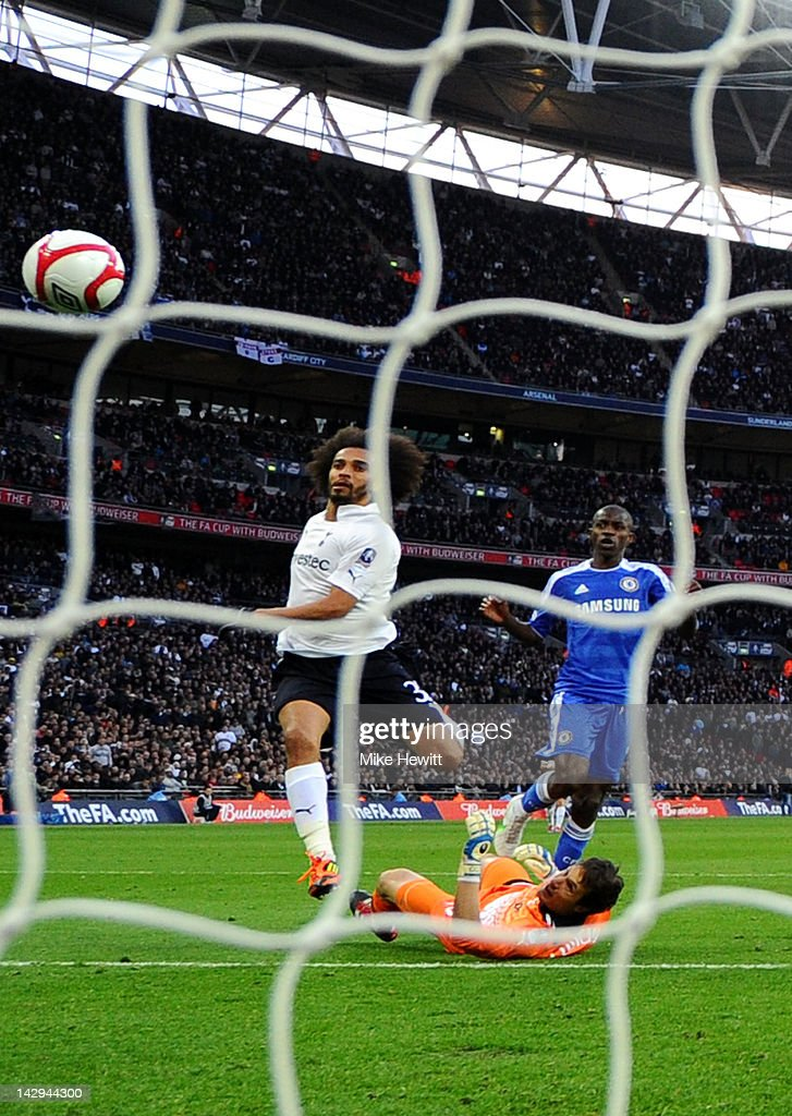 Ramires of Chelsea (R) beats <a gi-track='captionPersonalityLinkClicked' href=/galleries/search?phrase=Carlo+Cudicini&family=editorial&specificpeople=226724 ng-click='$event.stopPropagation()'>Carlo Cudicini</a> (23) and <a gi-track='captionPersonalityLinkClicked' href=/galleries/search?phrase=Benoit+Assou-Ekotto&family=editorial&specificpeople=709848 ng-click='$event.stopPropagation()'>Benoit Assou-Ekotto</a> of Tottenham Hotspur to scores their thrid goal during the FA Cup with Budweiser Semi Final match between Tottenham Hotspur and Chelsea at Wembley Stadium on April 15, 2012 in London, England.