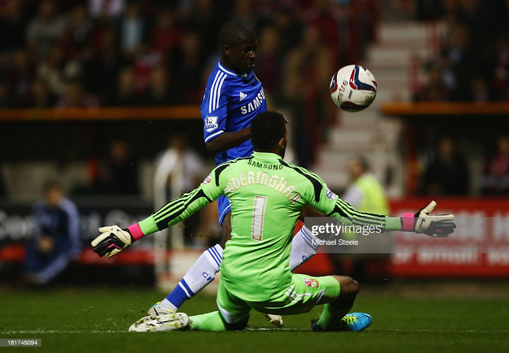 Ramires of Chelsea beats goalkeeper Wes Foderingham of Swindon Town to score their second goal during the Capital One Cup Third Round match between Swindon Town and Chelsea at County Ground on September 24, 2013 in Swindon, England.
